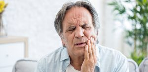 Man with tooth pain from a cracked tooth