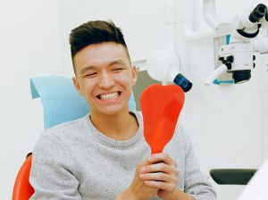 Smiling patient with beautiful straight teeth